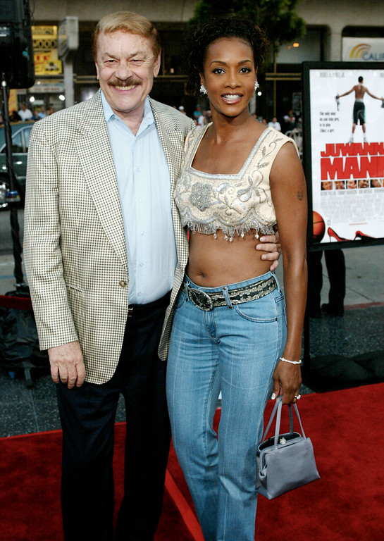 . LOS ANGELES, CA. - JUNE 18:  Los Angeles Lakers owner Dr. Jerry Buss (L) and actress Vivica A. Fox attend the film premiere of Juwanna Mann June 18, 2002 in Los Angeles, California.  The film opens in theaters nationwide June 21, 2002.  (Photo by Frederick M. Brown/Getty Images)
