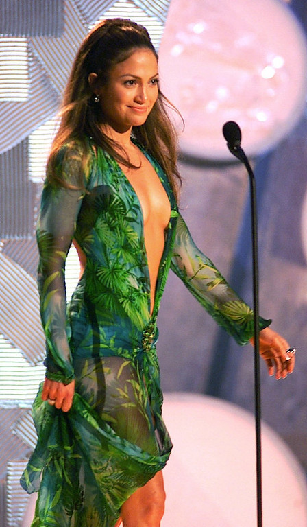 . Jennifer Lopez, perhaps the evening\'s most-talked-about celebrity with a gown cut in a loose V that left little to the imagination, appears on-stage during the 42nd Grammy Awards at the Staples Center in Los Angeles, Wednesday, Feb. 23, 2000. (AP Photo/Kevork Djansezian).