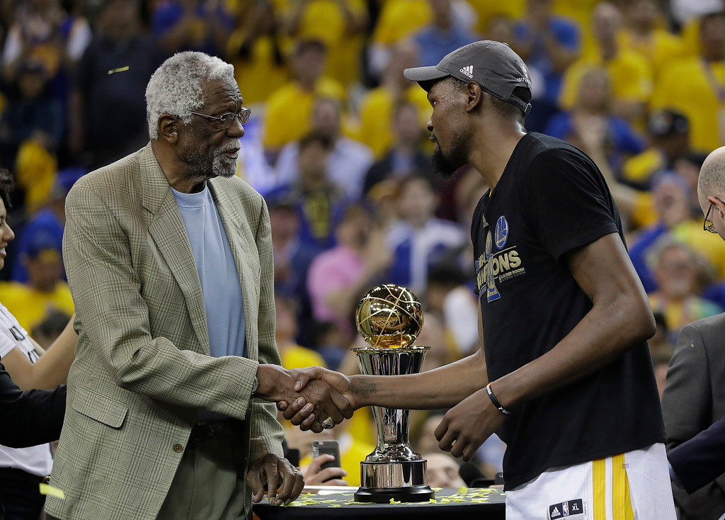 . Golden State Warriors forward Kevin Durant, right, shakes hands with Bill Russell as he is presented the Bill Russell NBA Finals Most Valuable Player Award after Game 5 of basketball\'s NBA Finals between the Warriors and the Cleveland Cavaliers in Oakland, Calif., Monday, June 12, 2017. The Warriors won 129-120 to win the NBA championship. (AP Photo/Marcio Jose Sanchez)