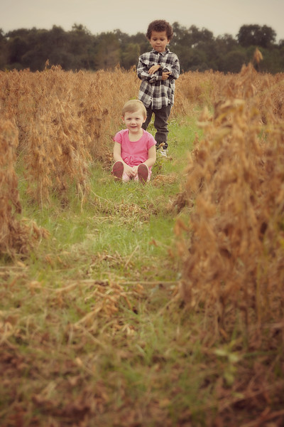 Kaylen and Korey in the soybean field.
