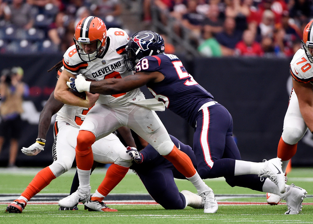 . Cleveland Browns quarterback Kevin Hogan (8) is sacked by Houston Texans linebacker Lamarr Houston (58) in the second half of an NFL football game, Sunday, Oct. 15, 2017, in Houston. (AP Photo/Eric Christian Smith)