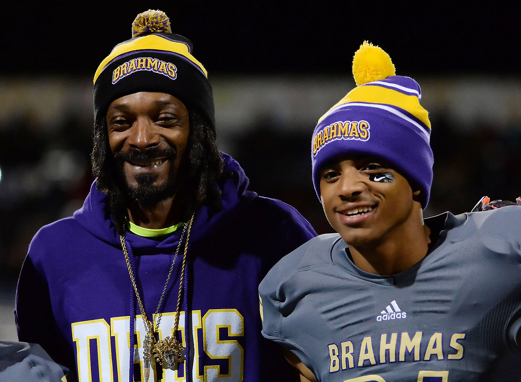 . Snoop Dogg (Calvin Cordozar Broadus, Jr.) with his son Diamond Bar\'s Cordell Broadus poses for pictures on parents night prior to a CIF-SS playoff football game against La Serna at Diamond Bar High School in Diamond Bar, Calif., on Friday, Nov. 22, 2013.   (Keith Birmingham Pasadena Star-News)