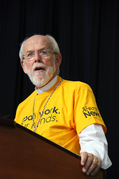 "Presiding Bishop Mark Hanson wears his  ""God's work. Our hands."" Sunday t-shirt."