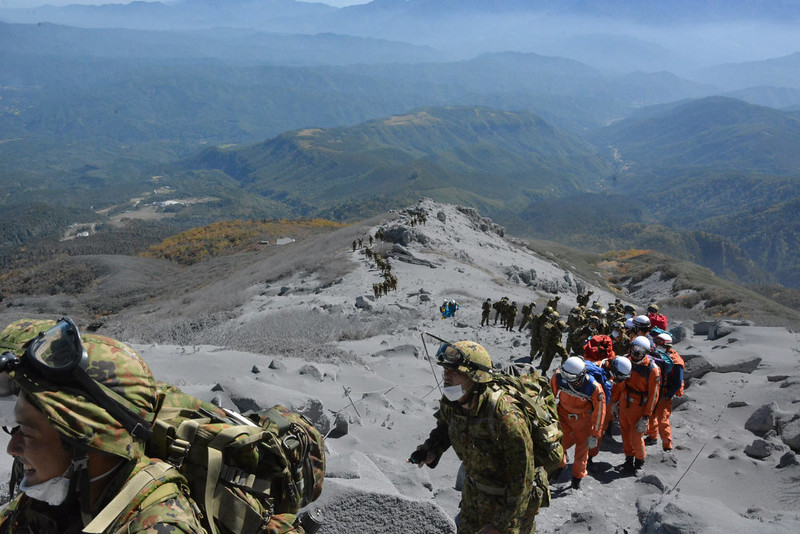 . This handout picture taken by Joint Staff on September 28, 2014 and released on September 29 shows Japan\'s Self Defense Force soldiers and rescue workers searching for survivors and missing climbers from the ash covered top of Mount Ontake at Nagano prefecture, one day after Japan\'s volcano Ontake erupted in central Japan, which straddling Nagano and Gifu prefecture. The grisly operation resumed to recover bodies after at least 31 people were believed killed when a Japanese volcano erupted, as survivors tell of people dying in front of them as tonnes of ash and rocks thundered from the sky.   AFP PHOTO / JOINT STAFF