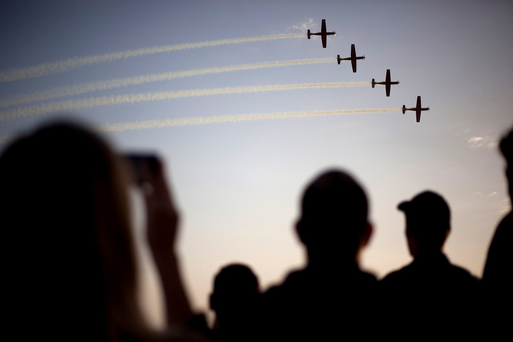 . Israeli Air Force acrobatic team T-6 Texan II planes perform during a graduation ceremony for new pilots in the Hatzerim air force base near the city of Beersheba, southern Israel, Thursday, Dec. 26, 2013. (AP Photo/Ariel Schalit)