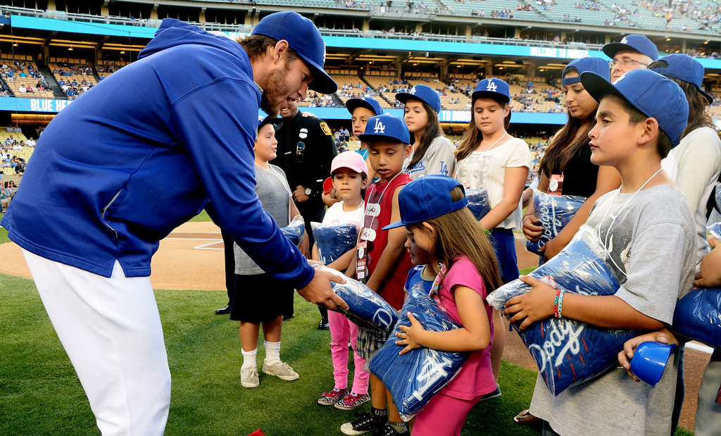 . Los Angeles Dodgers starting pitcher Clayton Kershaw hands out blankets to families as members of the San Fernando Valley Rescue Mission are treated to a Major league baseball game between the Miami Marlins and the Los Angeles Dodgers on Wednesday, May 14, 2014 in Los Angeles. The Mission experienced a devastating fire earlier this month. Damage sustained included the destruction of the San Fernando Valley Rescue Mission�s emergency shelter, vehicle fleet, clothing warehouse and food pantry which were vital in aiding those of need in the San Fernando Valley.  (Keith Birmingham/Pasadena Star-News)