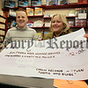 Darren Turtle manager of Carlin Records Newry presents a cheque for £192 to Fiona Stephens from Southern Area Hospice the proceeds of a on going campaign called Plastic into Silver. 06W45N1