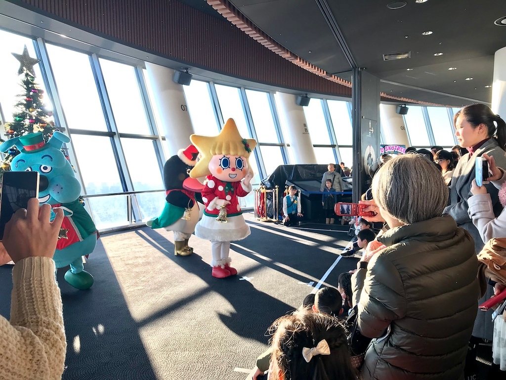 Mascots performing Christmas dances.