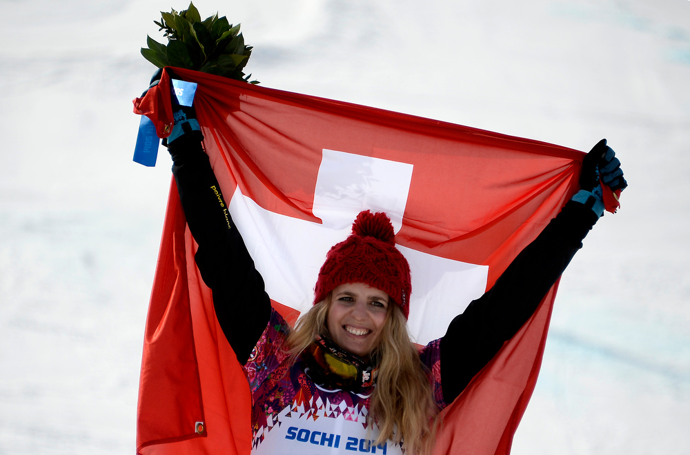 . Gold Medallist, Switzerland\'s Patrizia Kummer celebrates at the Women\'s Snowboard Parallel Giant Slalom Flower Ceremony at the Rosa Khutor Extreme Park during the Sochi Winter Olympics on February 19, 2014.  FRANCK FIFE/AFP/Getty Images