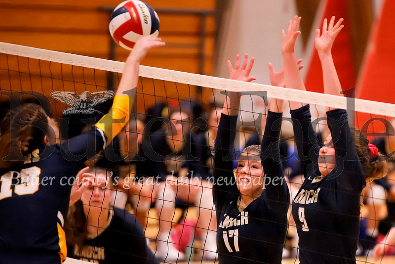 Knoch's Kennedy Christy (17) and Skylar Burkett go for a block over Emily Hayward of Mars during the Knights' 3-0 home win Tuesday. Seb Foltz/Butler Eagle