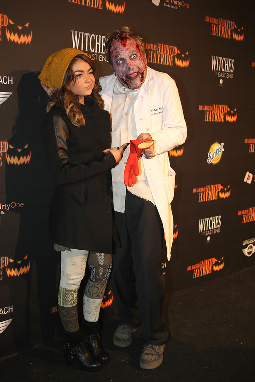 . An actor and Sarah Hyland at the 5th Annual Los Angeles Haunted Hayride Premiere Night on October 10, 2013.  The fifth year anniversary of the Los Angeles Haunted Hayride took Hayriders through scenes of actual hauntings.  The month-long event will once again take place in Griffith Park�s Old Zoo area, which has been home to murder, torture, paranormal activity, serial killers, and abduction. (Photos by Boris Issaei for the Los Angeles Daily News)