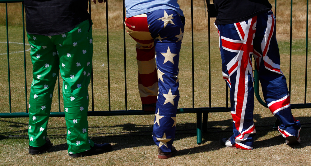 . Spectators wearing colourful trousers watch the second round of the British Open Golf Championship at Muirfield, Scotland, Friday July 19, 2013. (AP Photo/Jon Super)