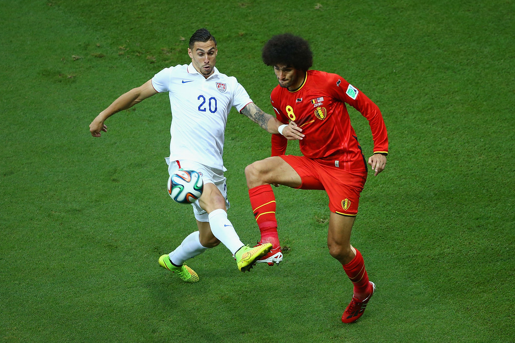 . Geoff Cameron of the United States challenges Marouane Fellaini of Belgium during the 2014 FIFA World Cup Brazil Round of 16 match between Belgium and the United States at Arena Fonte Nova on July 1, 2014 in Salvador, Brazil.  (Photo by Robert Cianflone/Getty Images)