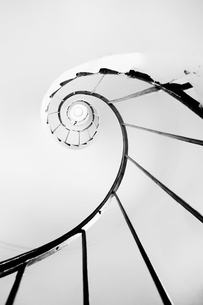 Spiral  I tried a little minimalistic B&W photography. This photo was taken with my 10-20mm lens, I then just cropped it, to make a better composition, as it was centered. Taken handheld inside the staircase of the Minaret in Lednice.