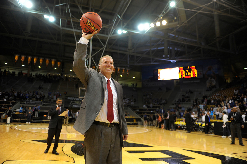 . BOULDER, CO. - MARCH 16: Raiders coach Carl Mattei accepted the game ball after the win. The Regis Jesuit High School girl\'s basketball team defeated Highlands Ranch 53-46 in the 5A championship game Saturday, March 16, 2013 at the Coors Events Center in Boulder.  (Photo By Karl Gehring/The Denver Post)