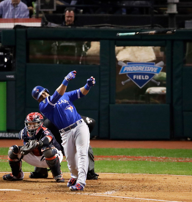 . Toronto Blue Jays\' Edwin Encarnacion lets go of his bat during the eighth inning against the Cleveland Indians in Game 1 of baseball\'s American League Championship Series in Cleveland, Friday, Oct. 14, 2016. (AP Photo/Charlie Riedel)