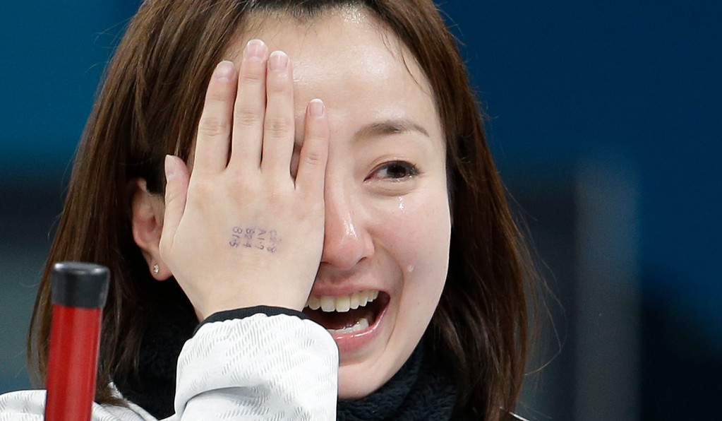 . Japan\'s skip Satsuki Fujisawa cries as she celebrates winning the women\'s bronze medal curling match against Britain at the 2018 Winter Olympics in Gangneung, South Korea, Saturday, Feb. 24, 2018. (AP Photo/Natacha Pisarenko)