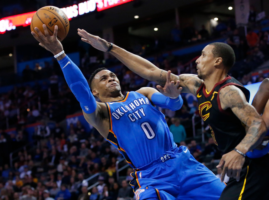 . Oklahoma City Thunder guard Russell Westbrook (0) shoots as Cleveland Cavaliers guard George Hill defends during the second half of an NBA basketball game in Oklahoma City, Tuesday, Feb. 13, 2018. (AP Photo/Sue Ogrocki)