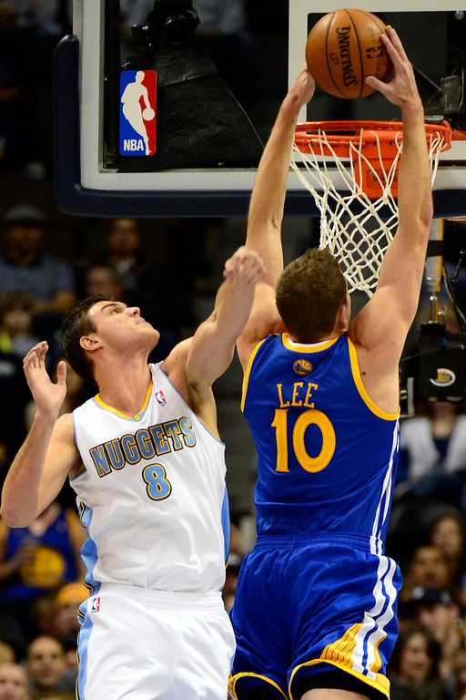 . Golden State Warriors power forward David Lee (10) dunks over Denver Nuggets small forward Danilo Gallinari (8) during the first half at the Pepsi Center on Sunday, January 13, 2013. AAron Ontiveroz, The Denver Post