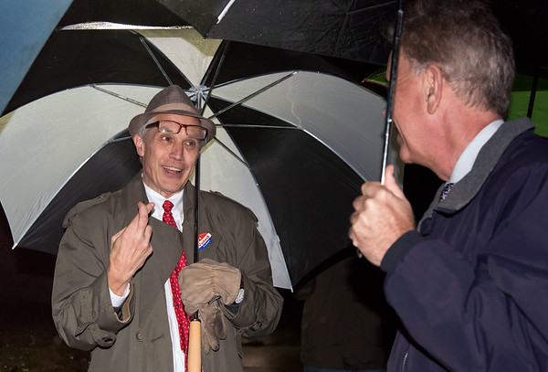 11/06/18 Wesley Bunnell | Staff State Rep. Peter Tercyak crosses his fingers for good luck while talking to Democratic candidate for governor Ned Lamont outside of the Pulaski Middle School voting location early Tuesday evening.