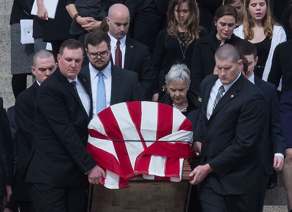 . Maureen McCarthy Scalia (C), follows her husband\'s casket as it is lead out of church after the funeral Mass for US Supreme Court Justice Antonin Scalia at the Basilica of the National Shrine of the Immaculate Conception in Washington, DC,  on February 20, 2016.  Scalia died on February 13 at the age of 79. / AFP / Nicholas KAMM/AFP/Getty Images