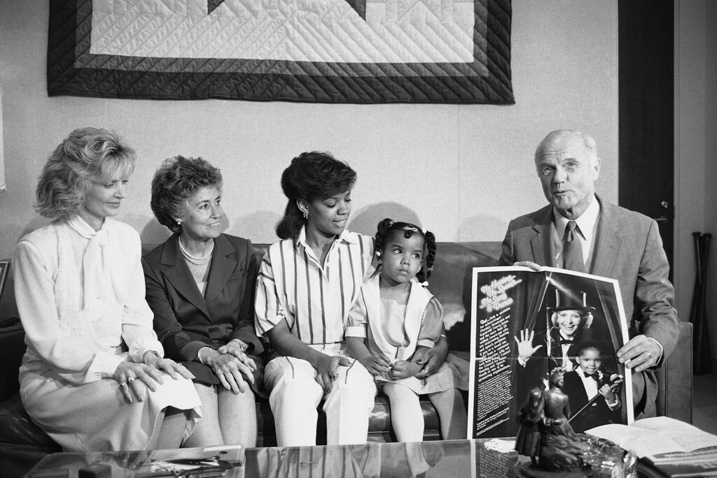 . Sen. John Glenn, D-Ohio, right, with actress Florence Henderson, far left, and his wife Annie, second from left, meet with Nancy Jones, age 6, and her mother Yvette Jones in his Capitol Hill office in Washington, Thursday, May 2, 1985, to promote Better Hearing and Speech Month. Jones is from Warrensville Heights, Ohio. (AP Photo/Ron Edmonds)
