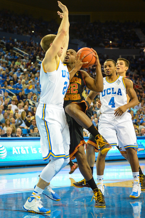 . USC�s Byron Wesley drives up in UCLA�s Travis Wear during game action at Pauley Pavilion Sunday, December 5, 2014. UCLA  defeated USC 107-73.  Photo by David Crane/Los Angeles Daily News.