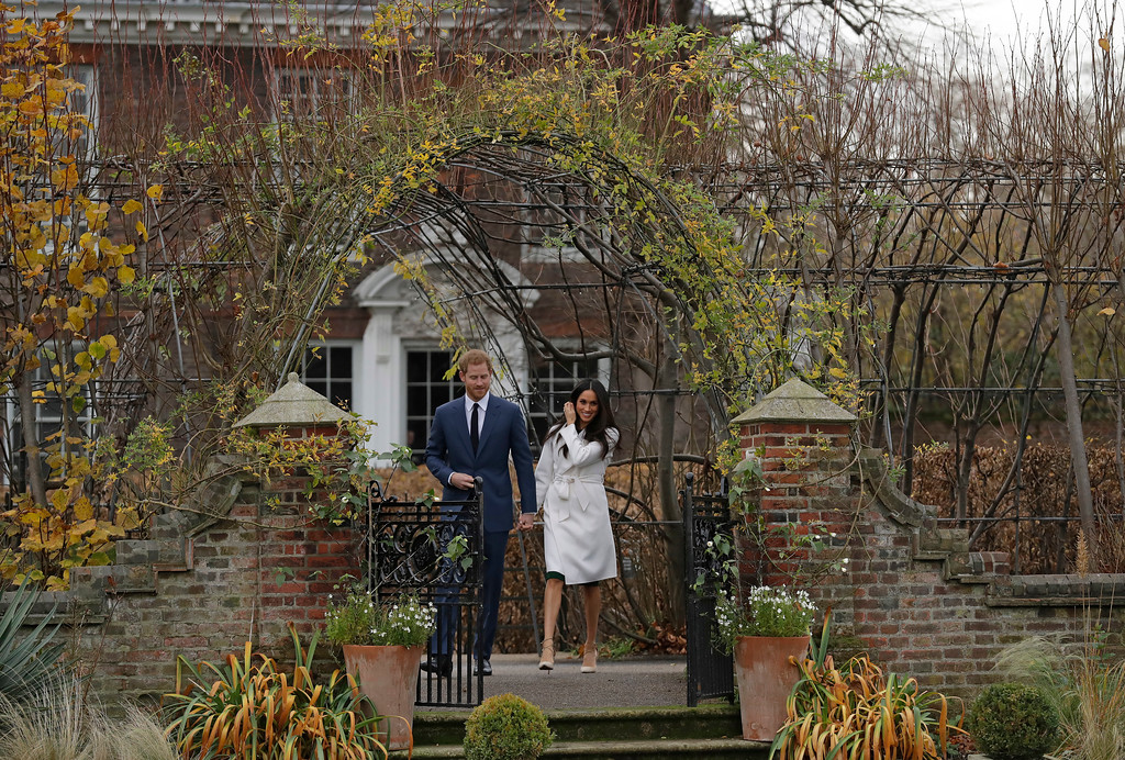 . Britain\'s Prince Harry and his fiancee Meghan Markle arrive for a photocall in the grounds of Kensington Palace in London, Monday Nov. 27, 2017. Britain\'s royal palace says Prince Harry and actress Meghan Markle are engaged and will marry in the spring of 2018. (AP Photo/Matt Dunham)