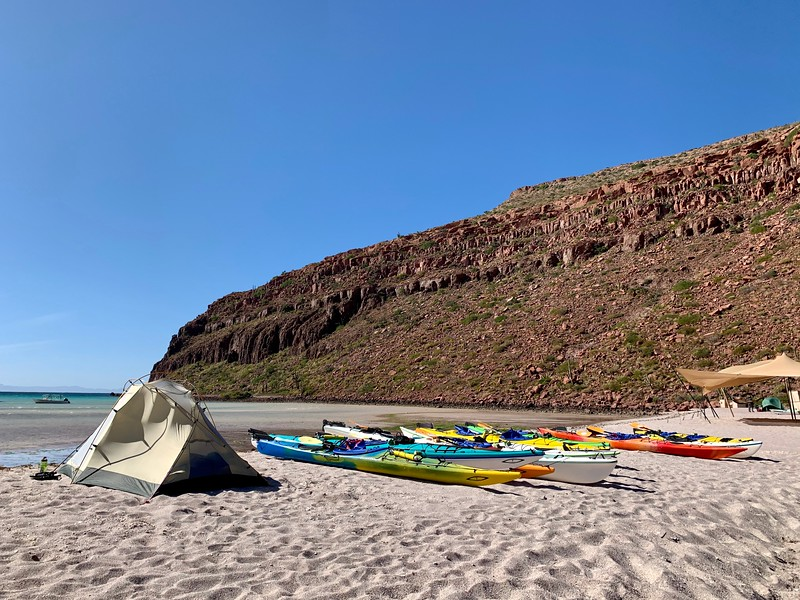 Tent and kayaks at campsite Candelero on Isla Espiritu Santo Baja Mexico