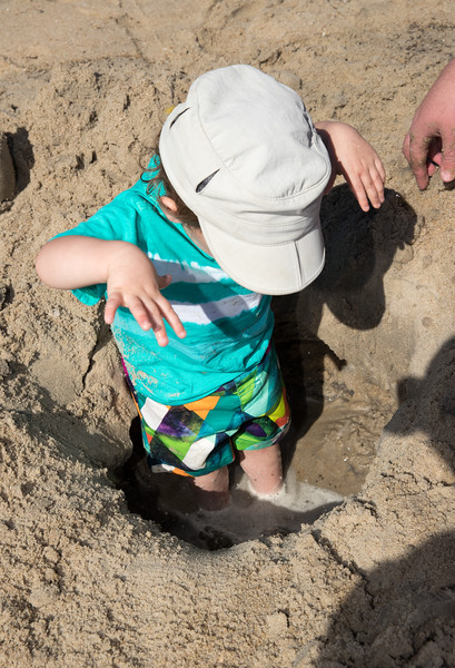 Caleb with toes in water hole.jpg