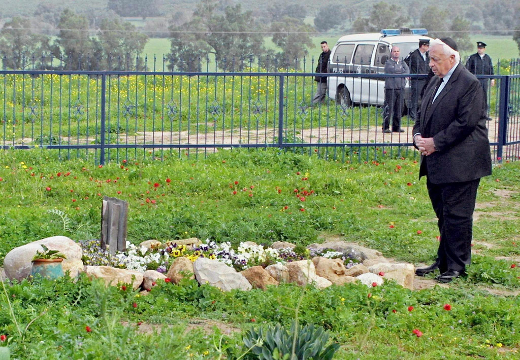 . A file photograph dated 07 February 2001 shows then Israeli Prime Minister-elect Ariel Sharon visiting the grave of his wife Lily at his Shikmim Farm in the northern Negev desert.   EPA/DANNY SOLOMON