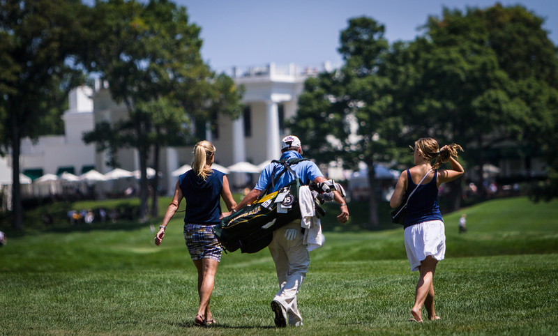 Player and two friends walk up the 16th fairway with the clubhouse in the background during second round medal play at the 2012 Western Amateur Championship at Exmoor Country Club in Highland Park IL. on Wednesday, August 1, 2012. (WGA Photo/Charles Cherney)