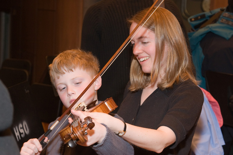 Mimi Cukier, violin, with child -- Hopkins Symphony Orchestra, March 2008