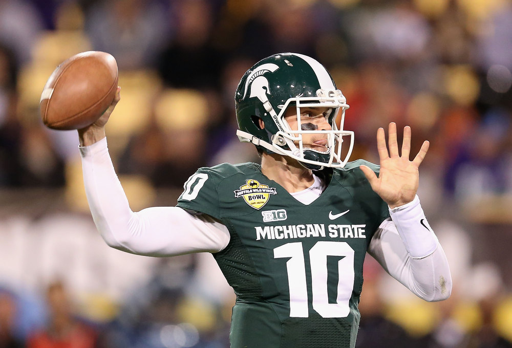 . Quarterback Andrew Maxwell #10 of the Michigan State Spartans throws a pass during the Buffalo Wild Wings Bowl against the TCU Horned Frogs at Sun Devil Stadium on December 29, 2012 in Tempe, Arizona.  (Photo by Christian Petersen/Getty Images)