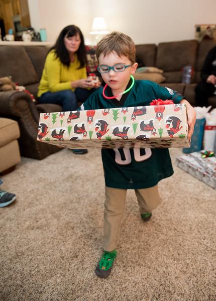 Caleb Carrying Large Present.jpg