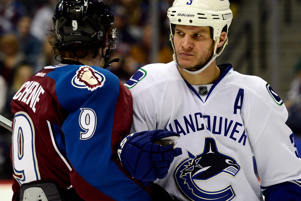 . DENVER, CO - MARCH 24: Kevin Bieksa (3) of the Vancouver Canucks bumps Matt Duchene (9) of the Colorado Avalanche during the third period of action. The Colorado Avalanche lost to the Vancouver Canucks 3-2 at the Pepsi Center. (Photo by AAron Ontiveroz/The Denver Post)