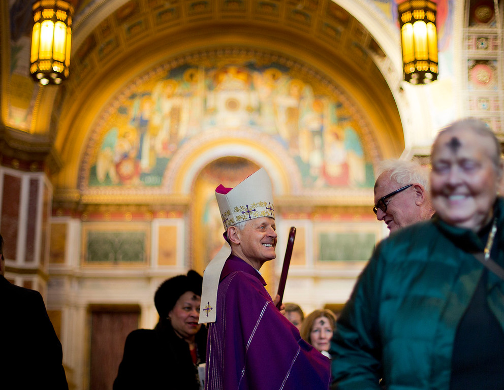. Cardinal Donald Wuerl of Washington, center, greets parishioners at an Ash Wednesday Mass at the Cathedral of St. Matthew the Apostle in Washington Wednesday, Feb. 18, 2015. Ash Wednesday marks the beginning of Lent, a time when Christians prepare for Easter through acts of penitence and prayer. (AP Photo/Pablo Martinez Monsivais)
