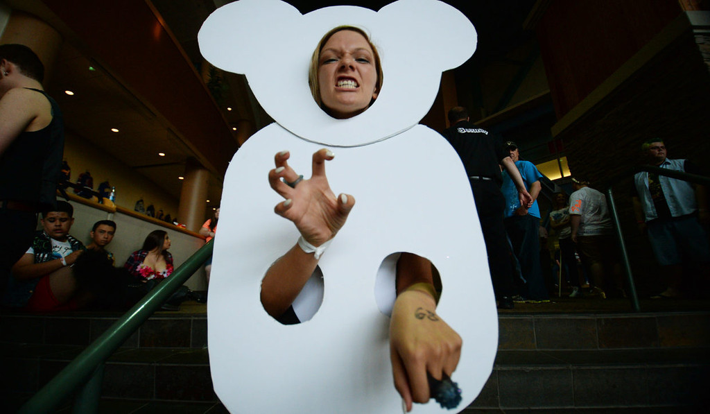 . Allison Moushey from St. Louis, Mo., wears a teddy bear cutout as she poses for a photo before the concert.  (Pioneer Press: John Autey)