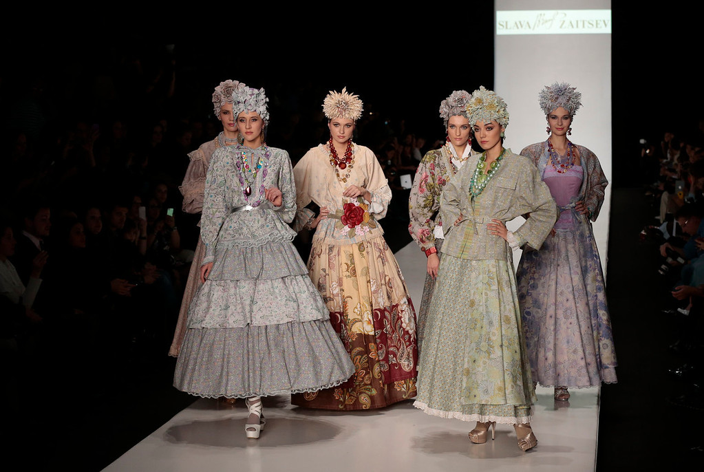. Models wear creations by Russian designer Slava Zaitsev at the Fashion Week in Moscow, Russia, on Saturday, Oct. 26, 2013. (AP Photo/Ivan Sekretarev)