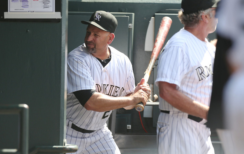 . Upset after being ejected from the game, Colorado Rockies manager Walt Weiss takes a bat and smashes it into the wall by the batting rack in his team\'s dugout on his way to the showers against the Atlanta Braves in the eighth inning of the Rockies\' 10-3 victory in a baseball game in Denver on Thursday, June 12, 2014. Weiss was upset over the Rockies\' Corey Dickerson being hit by a pitch thrown by Braves relif pitcher David Carpenter. (AP Photo/David Zalubowski)
