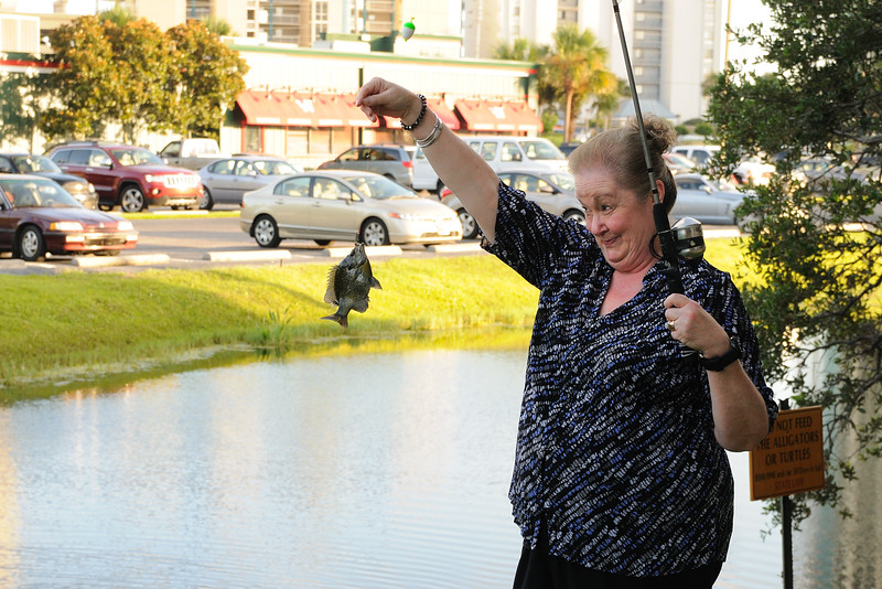 When I got back, Cynthia got excited when she saw something in the water and was determined to fish.  Dave, again, baited her hook with some leftover bread and she reeled in a bream.  She was doing the happy dance.