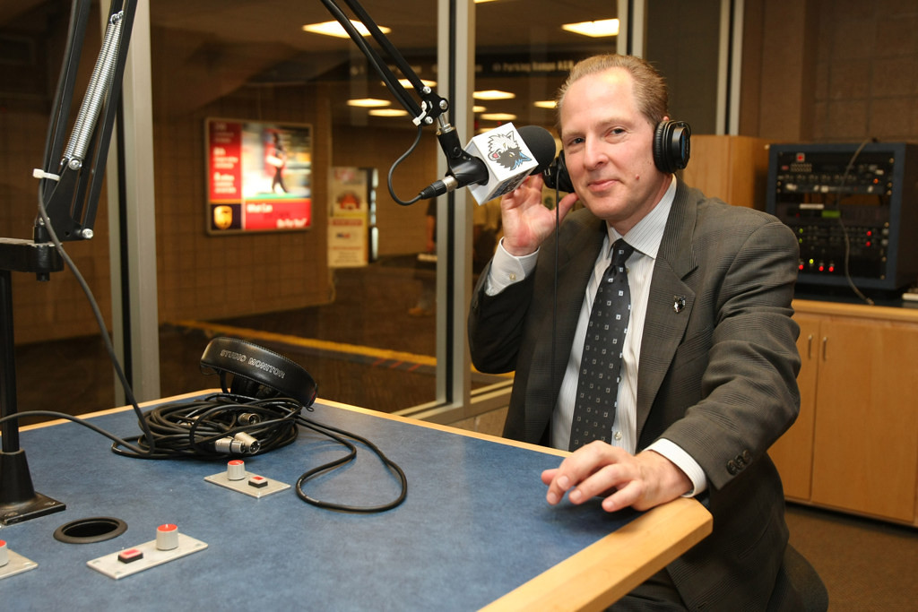 . David Kahn is interviewed on the radio after the press conference announcing his appointment as president of basketball operations at Target Center in Minneapolis on May 22, 2009.  (Photo by David Sherman/NBAE via Getty Images)