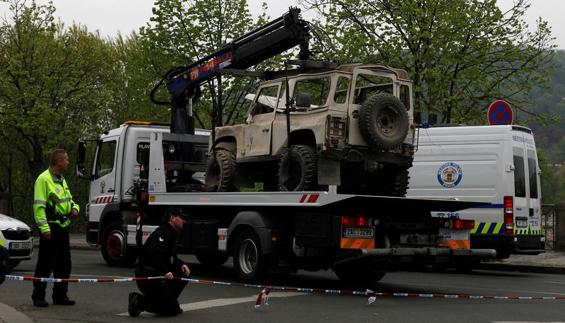 . A car damaged by an explosion is towed away by police in Prague April 29, 2013. The explosion in central Prague on Monday, probably caused by gas, injured as many as 40 people, officials said, and neighboring buildings - including the National Theatre - had to be evacuated.        REUTERS/Petr Josek