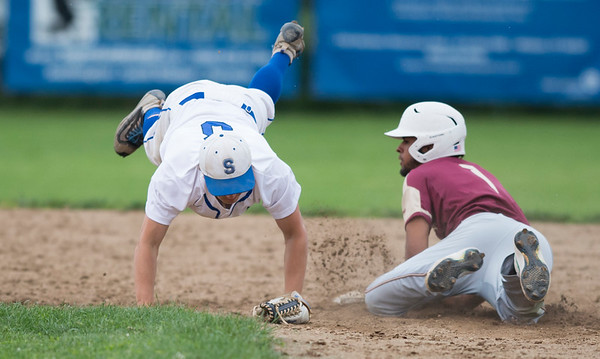 05/29/19 Wesley Bunnell | Staff New Britain and Southington baseball played to a 2-2 tie in the bottom of the 10th inning before the game was postponed due to rain. The game is scheduled to resume May 30th at 3:00pm. Bryce Worth (3) is upended by Danniel Rivera (1).