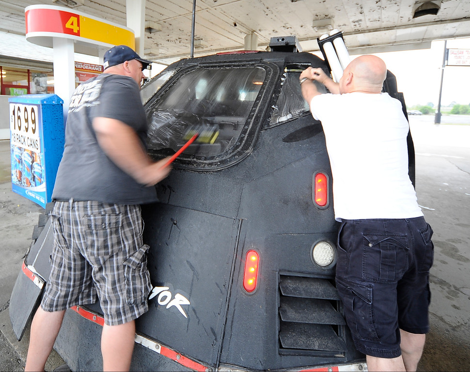 . April 27,2014. Saillisaw OK. USA. Dominator\'s crew members get the  Dominator ready to chase, as Meteorologist and Extreme Storm Chaser, Reed Timmer, with his 3 storm chase cars called the Dominator\'s, get ready to chase some tornados.