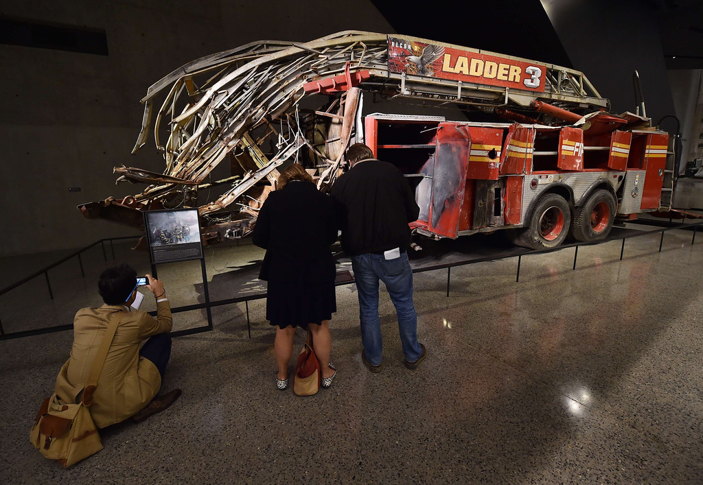 . Remains of a New York City Fire Department Ladder Company 3 truck just outside the Historical Exhibition area during a press preview of the National September 11 Memorial Museum at the World Trade Center site May 14, 2014 in New York. AFP PHOTO/Stan HONDA/AFP/Getty Images