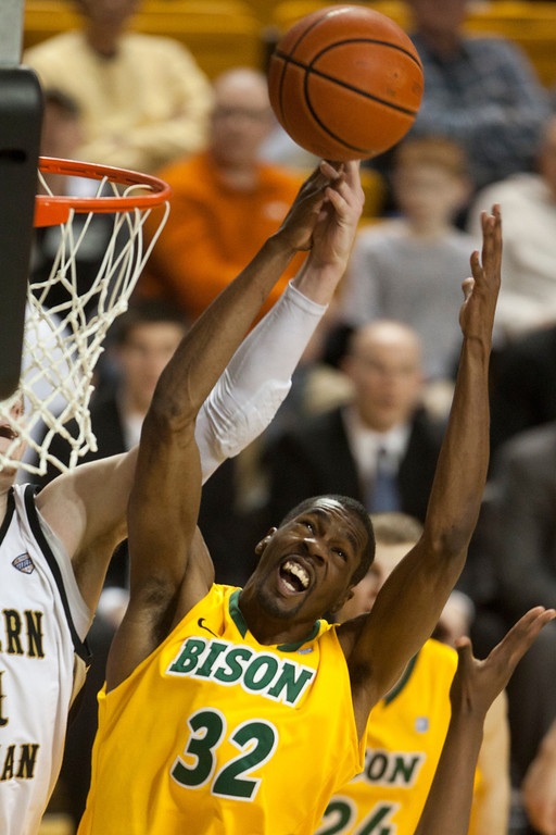 . North Dakota State forward TrayVonn Wright tries to grab a rebound in the second half of their game with Western Michigan. Western Michigan University beat North Dakota State 72-71 in overtime in their College Basketball Invitational tournament game in Kalamazoo Wednesday March 20, 2013.  (AP Photo/Kalamazoo Gazette, James Buck)