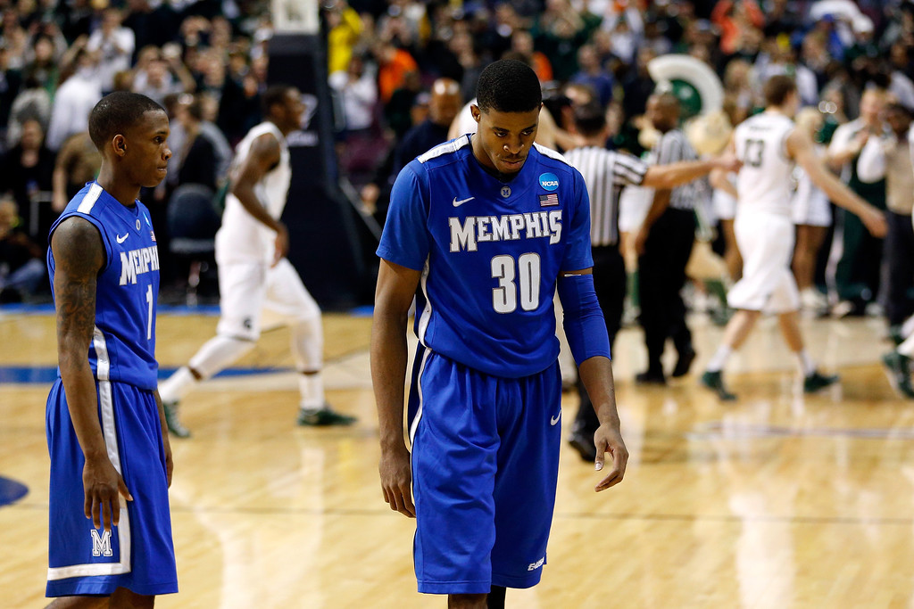 . AUBURN HILLS, MI - MARCH 23:  (L-R) Joe Jackson #1 and D.J. Stephens #30 of the Memphis Tigers walk off of the court after they lost 70-48 against the Michigan State Spartans during the third round of the 2013 NCAA Men\'s Basketball Tournament at The Palace of Auburn Hills on March 23, 2013 in Auburn Hills, Michigan.  (Photo by Gregory Shamus/Getty Images)