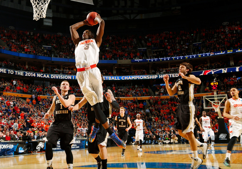 . Syracuse\'s Jerami Grant (3) drives past Western Michigan\'s Austin Richie, right, and Tucker Haymond (1) during the first half of a second-round game in the NCAA college basketball tournament in Buffalo, N.Y., Thursday, March 20, 2014. (AP Photo/Bill Wippert)
