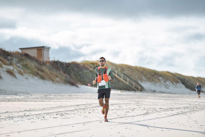 Running along the beach
